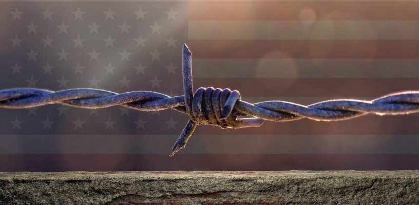 barbed wire across US flag